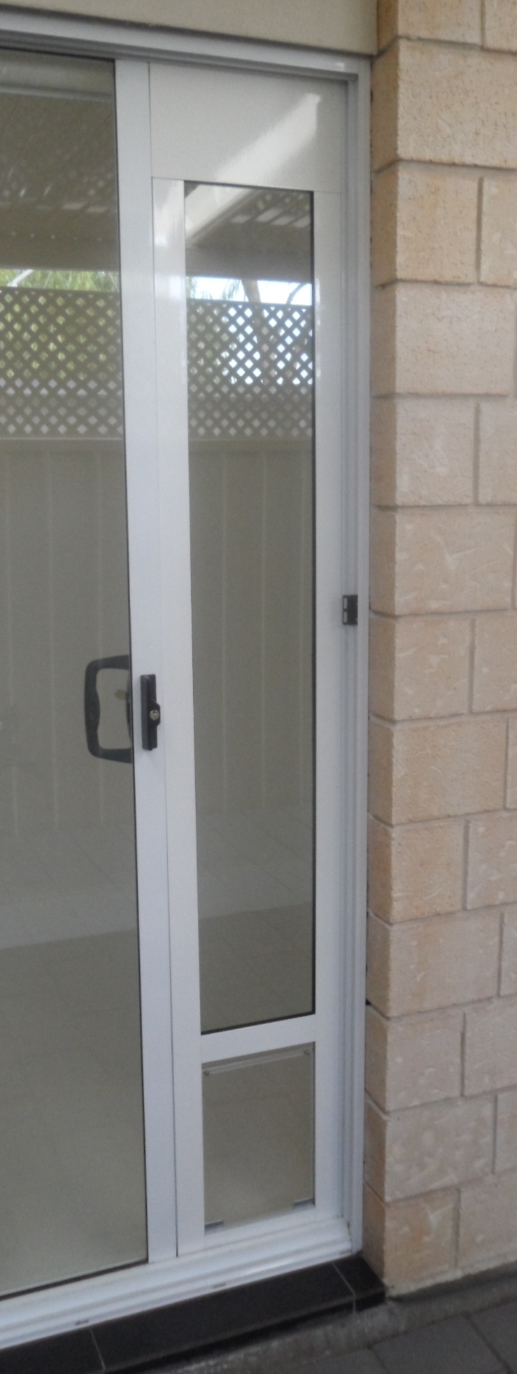 Sliding screen door sliding screen door with pet door for Built in sliding doors